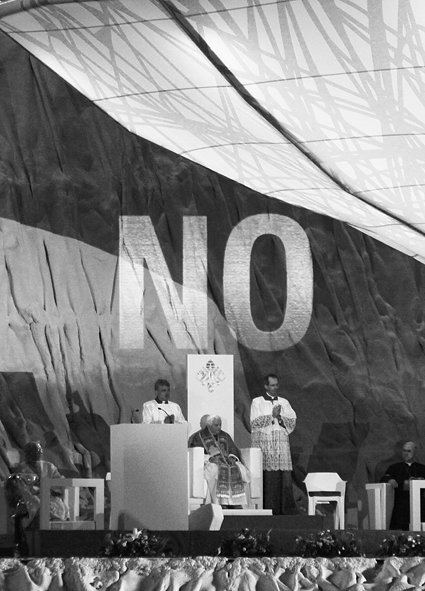 "Pope with ""NO"" projected above."